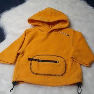 Yellow soft sweatshirt with front zipper pocket